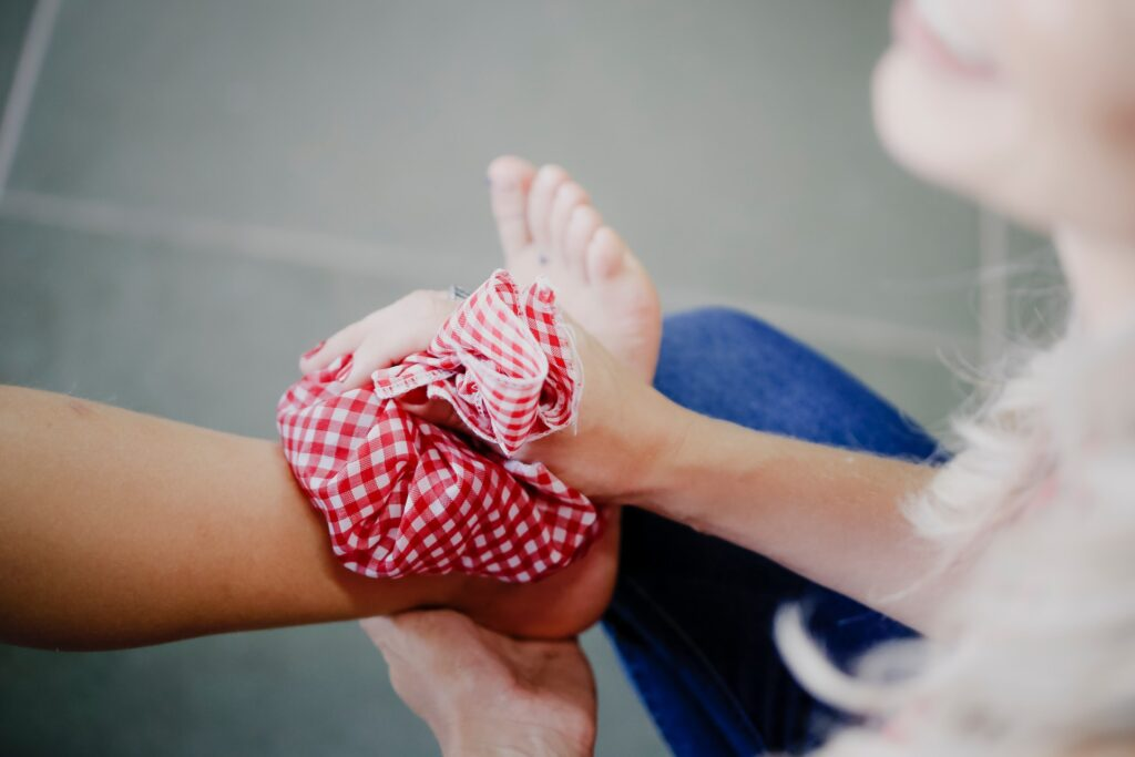 ice pack being applied to ankle